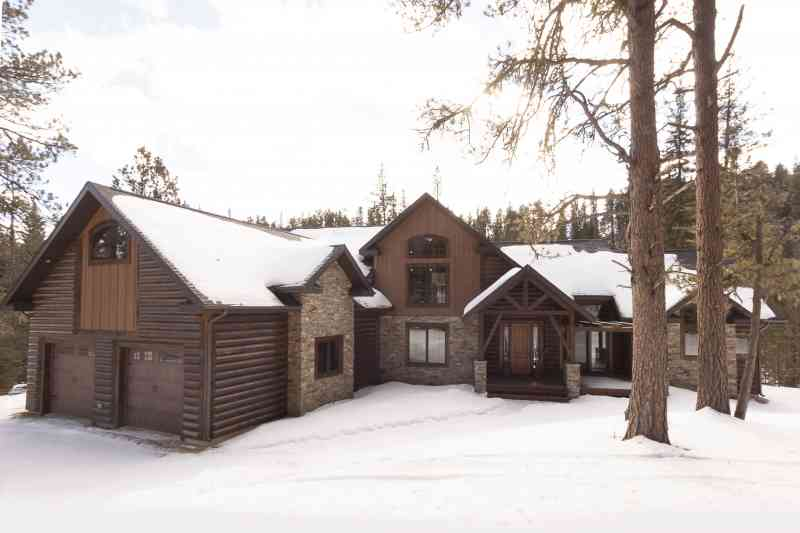 This home has some great variety in it's siding choices: log siding, stone, and barn-wood board and baton siding.