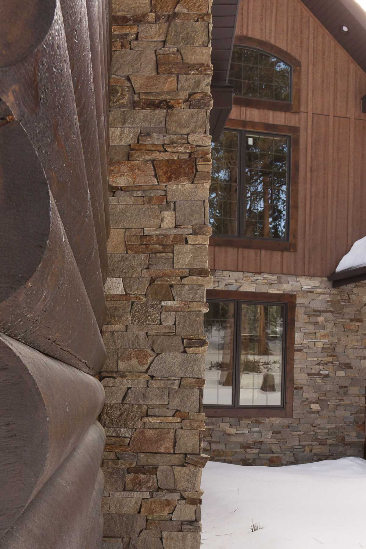 A close-up of the log and stone exterior pieces.