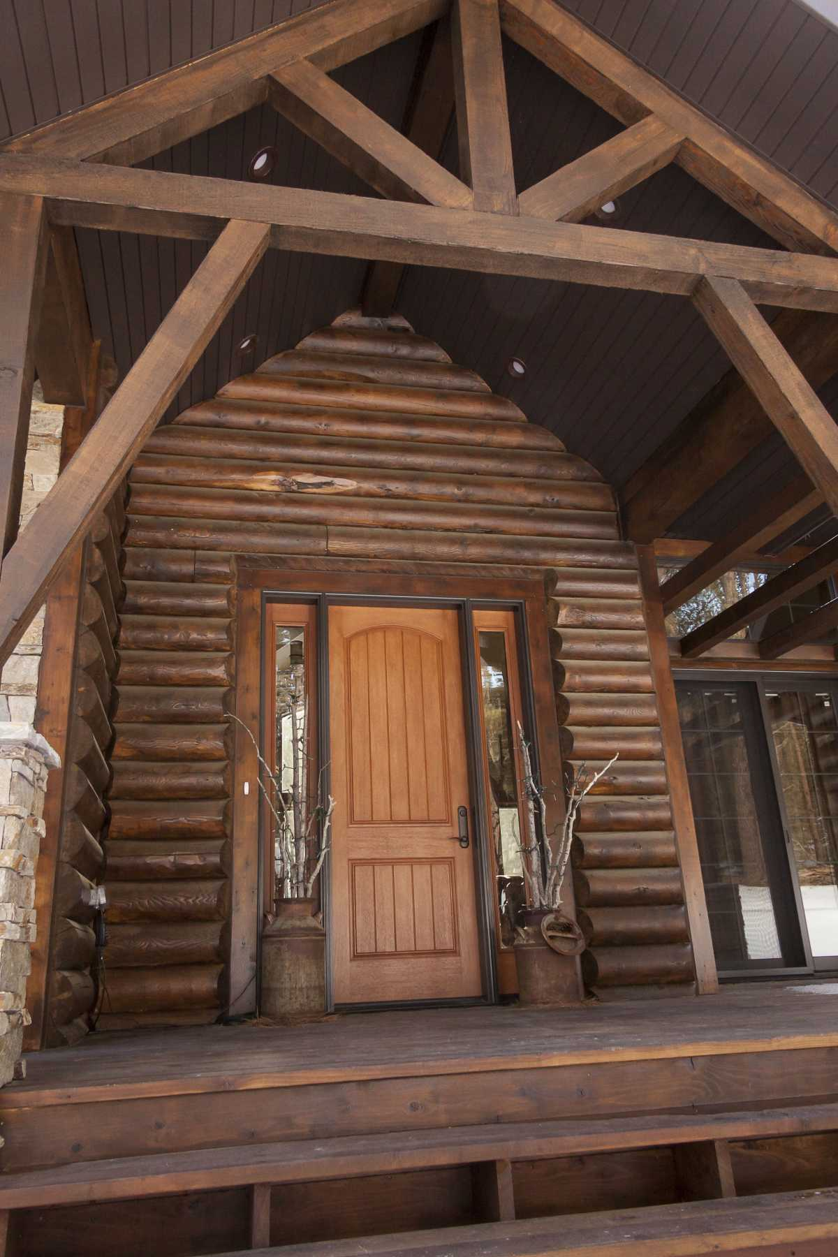 The rustic entry door and its coordinating decor.