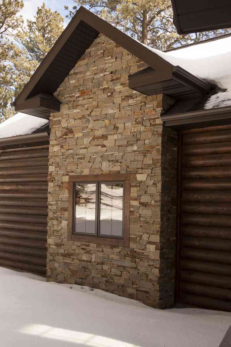 The exterior stone wall accent.