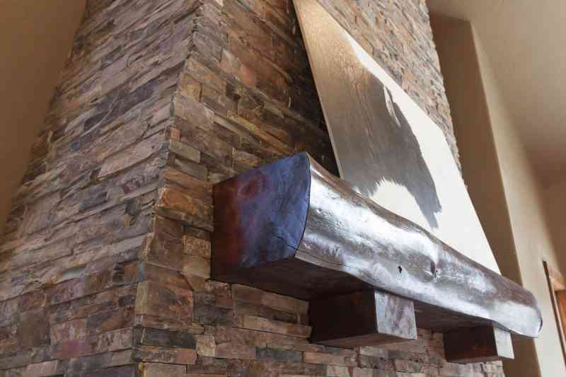 The hand-crafted fireplace mantle piece.