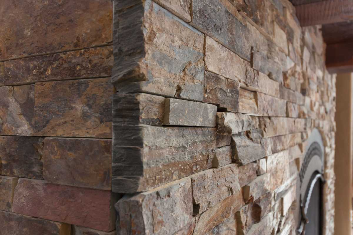 A detailed view of the tapered stone edge on the interior fireplace.