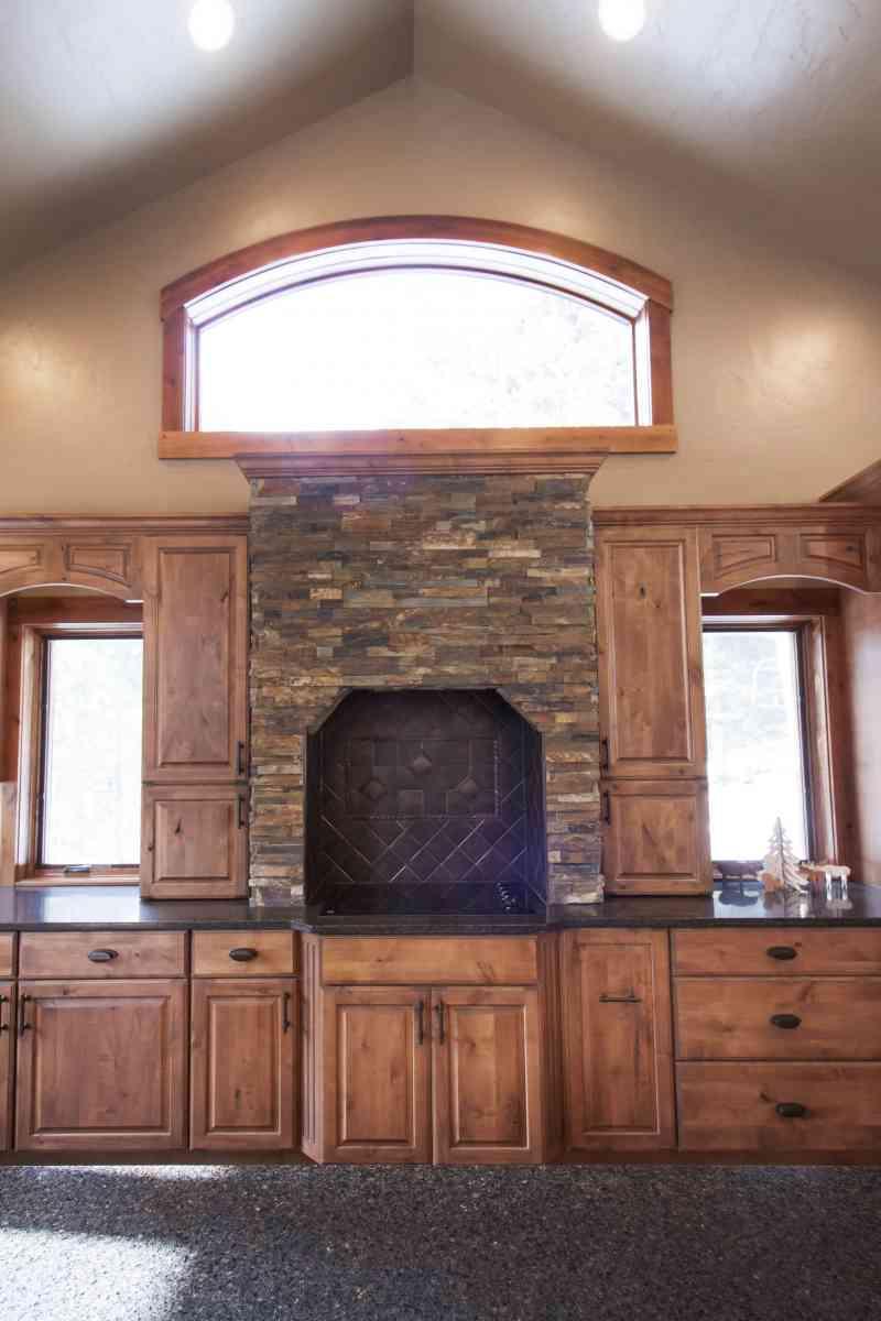 The stunning custom designed stone stove surround.