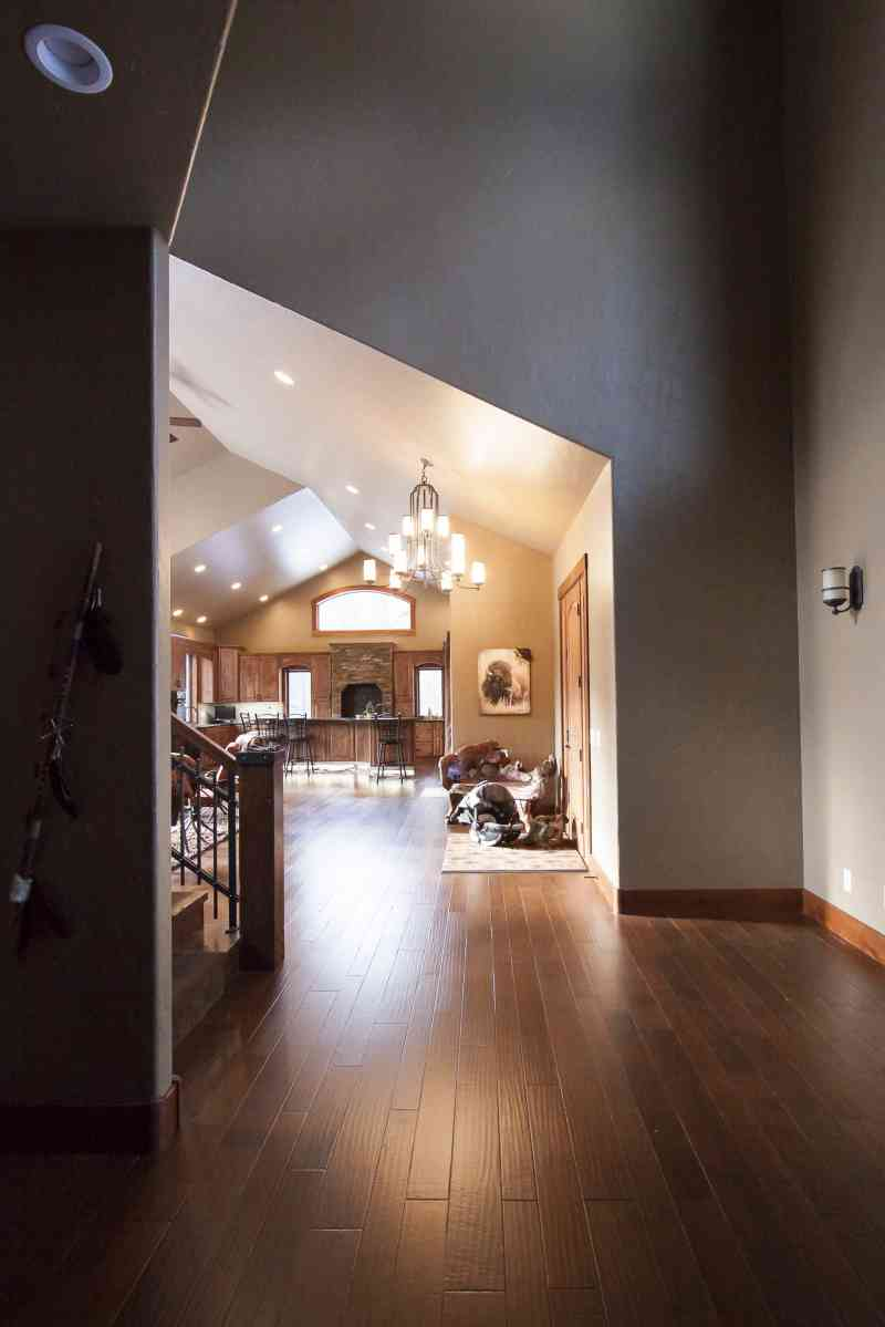 The entry door leads into the foyer and the open-concept living room and kitchen.