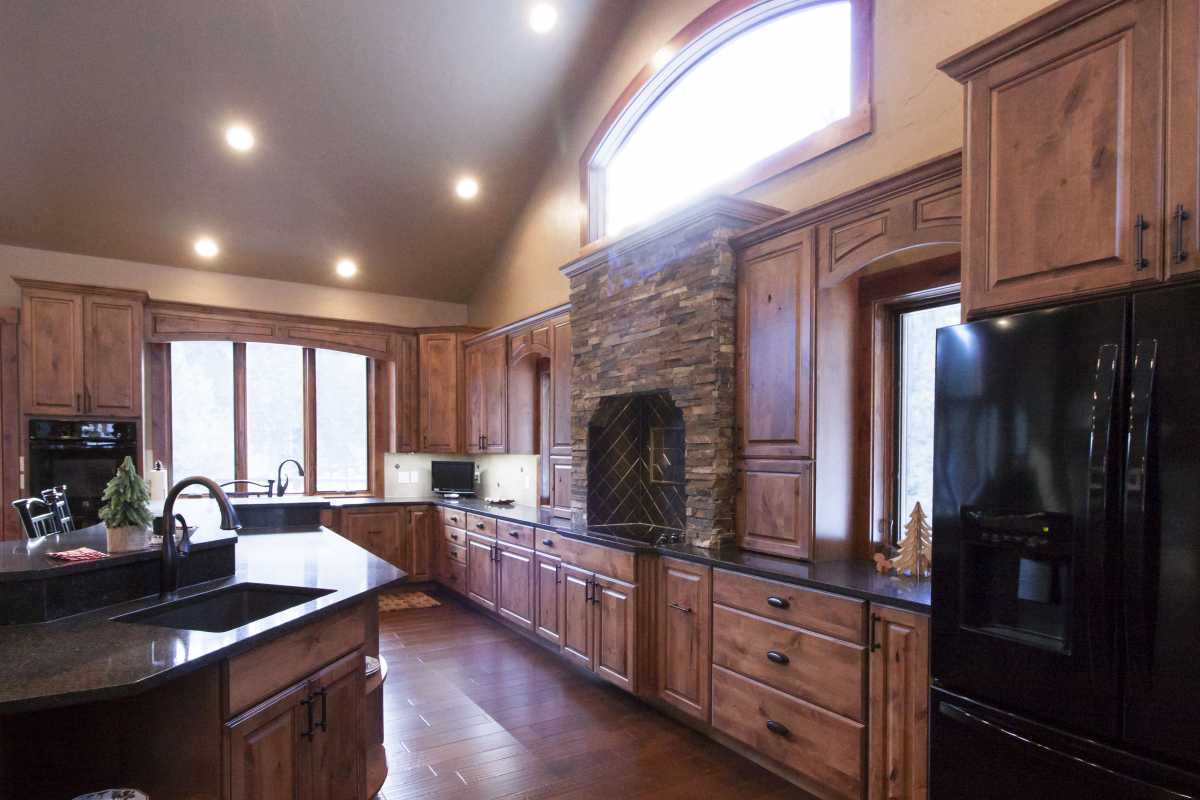 The gorgeous stone surround is a focal point in this kitchen!