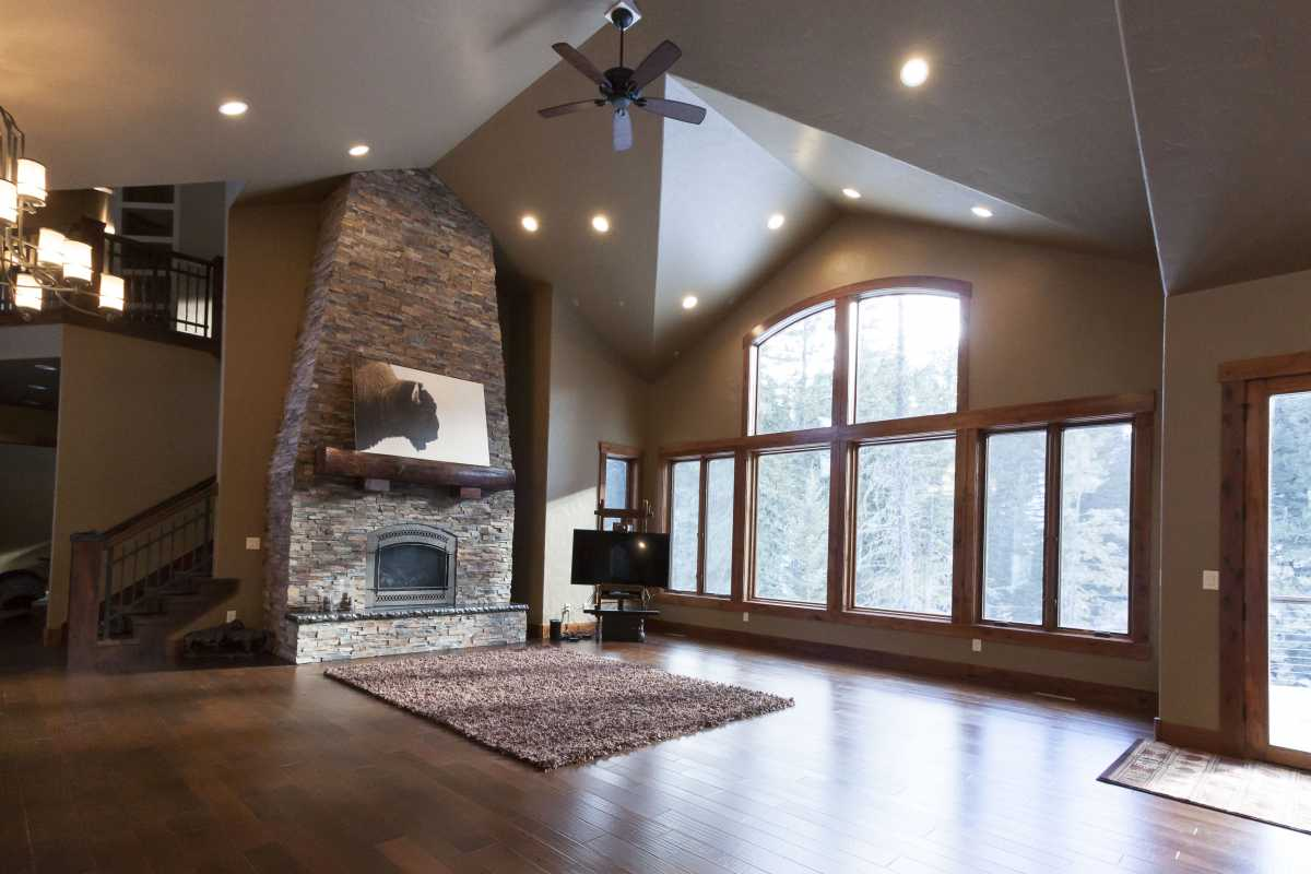 The focal point of the living room - a tapered stone fireplace.