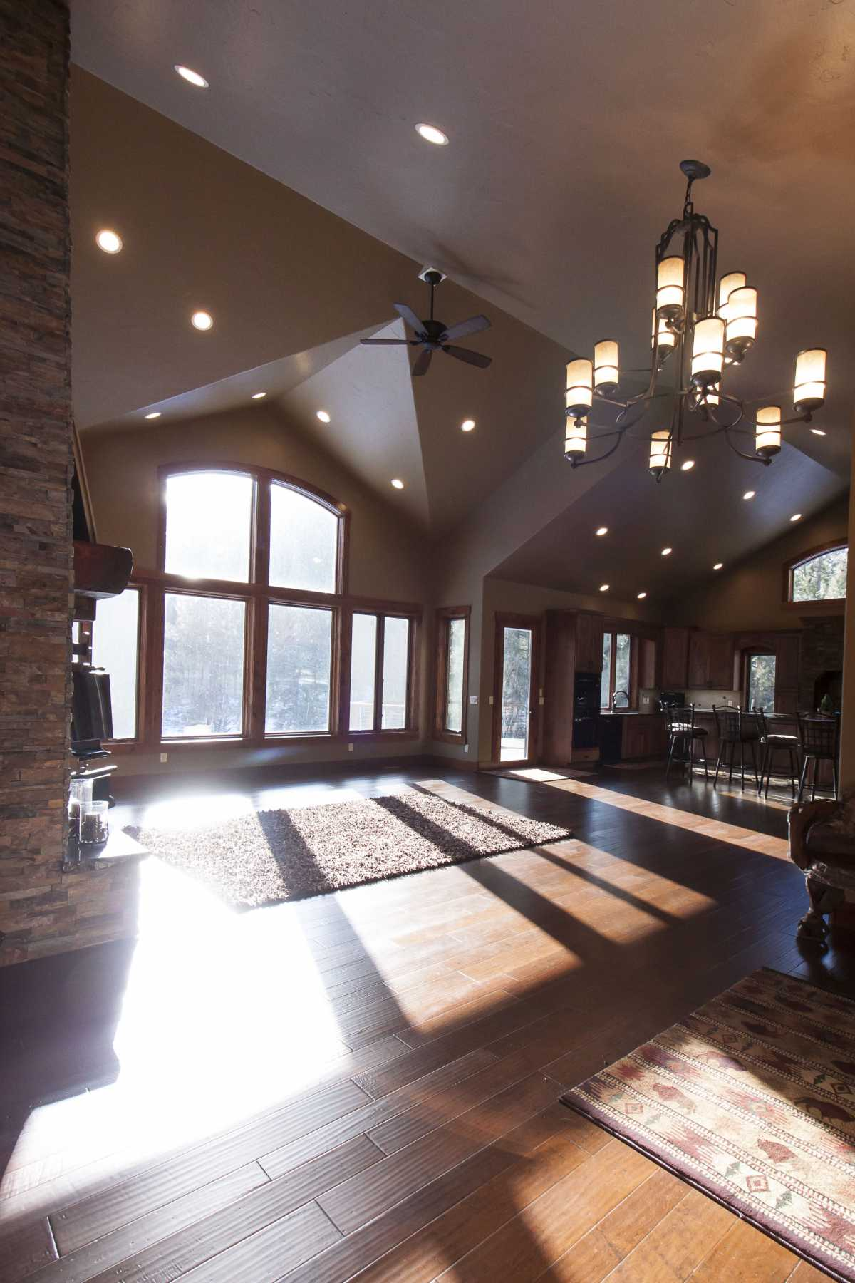 The large great room windows bring in a lot of light and are highlighted by custom-built arched trim.
