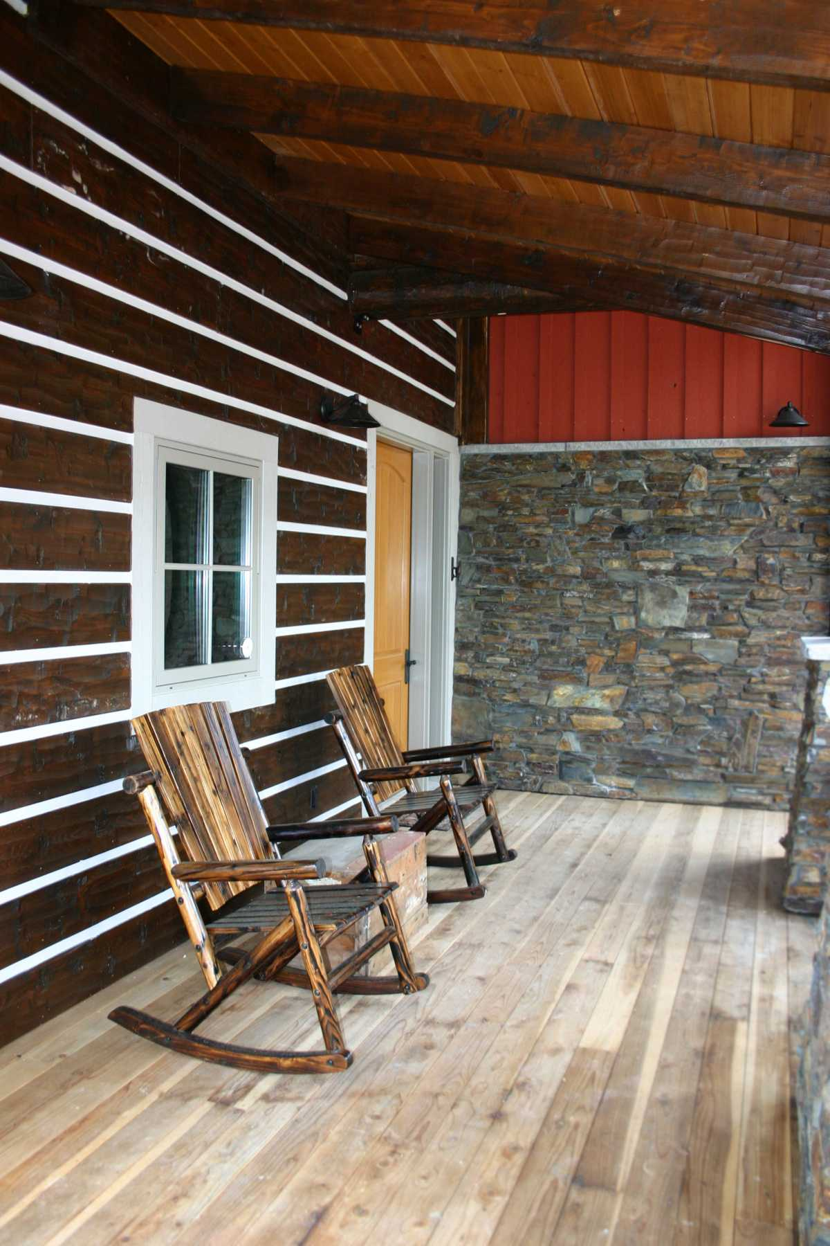The cozy back porch complete with rustic rocking chairs!