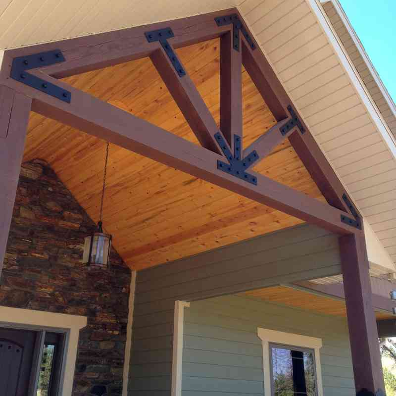 A Timberline signature - rustic gable trusses with steel plates.