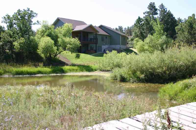 A beautiful backyard pond and bridge add charm to this country home!