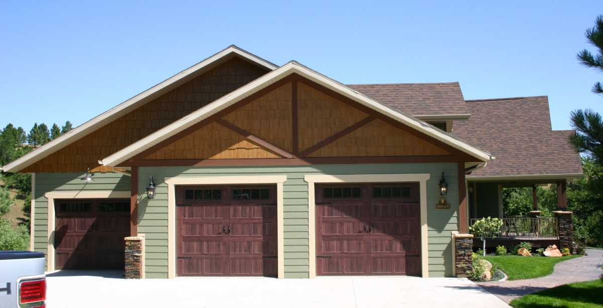 A spacious 3-car garage with gorgeous wooden doors!