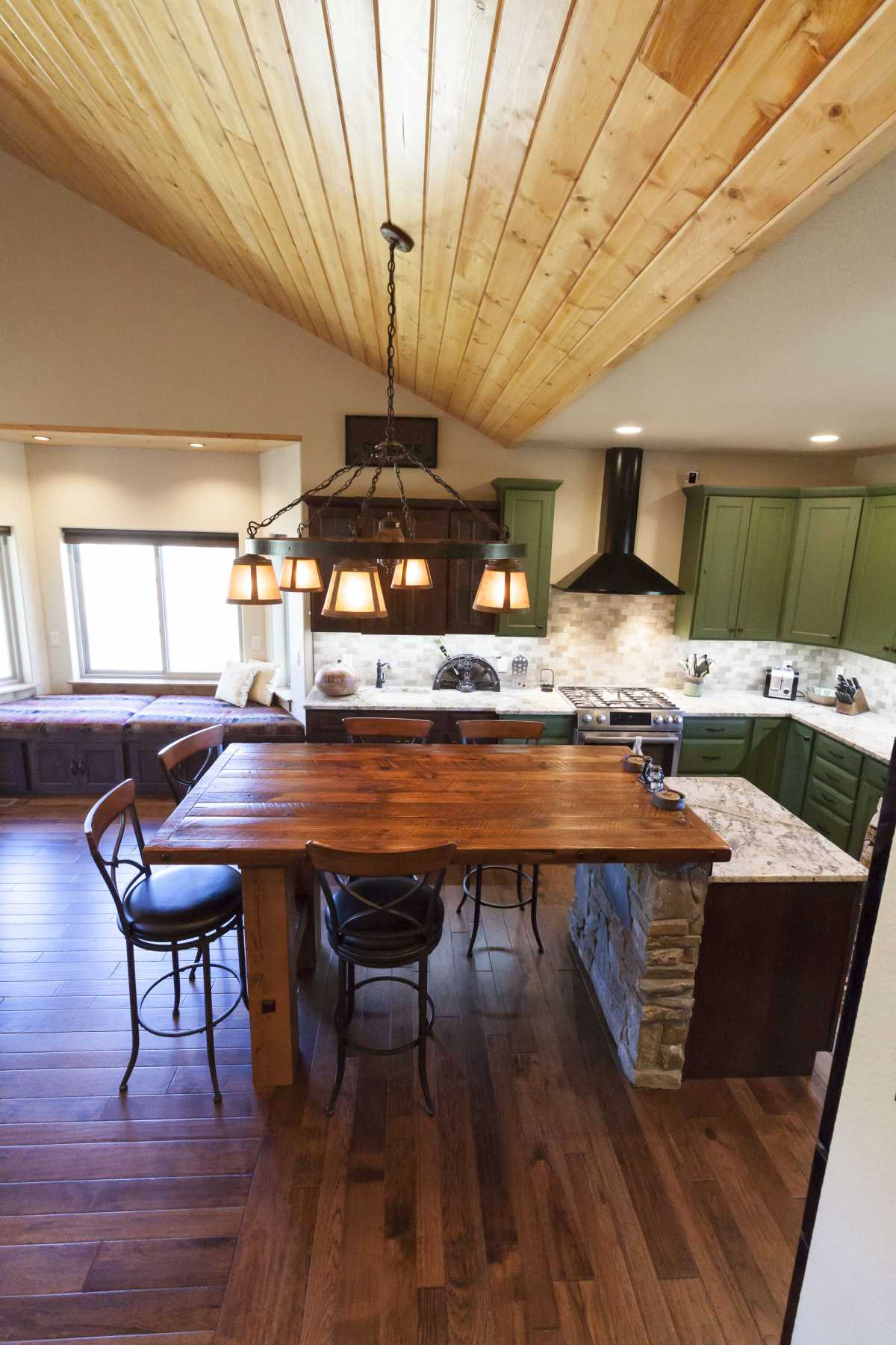 An open concept kitchen and living area is complimented by the high ceilings.