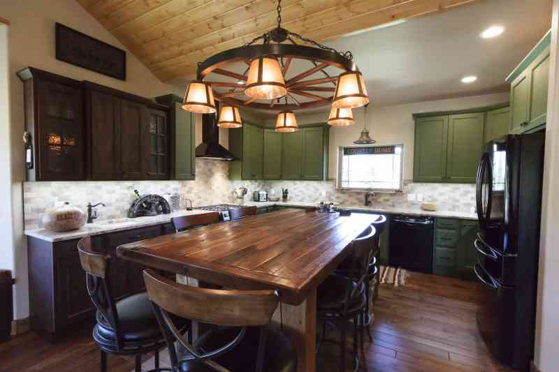The gorgeous island table is the focal point for this kitchen!