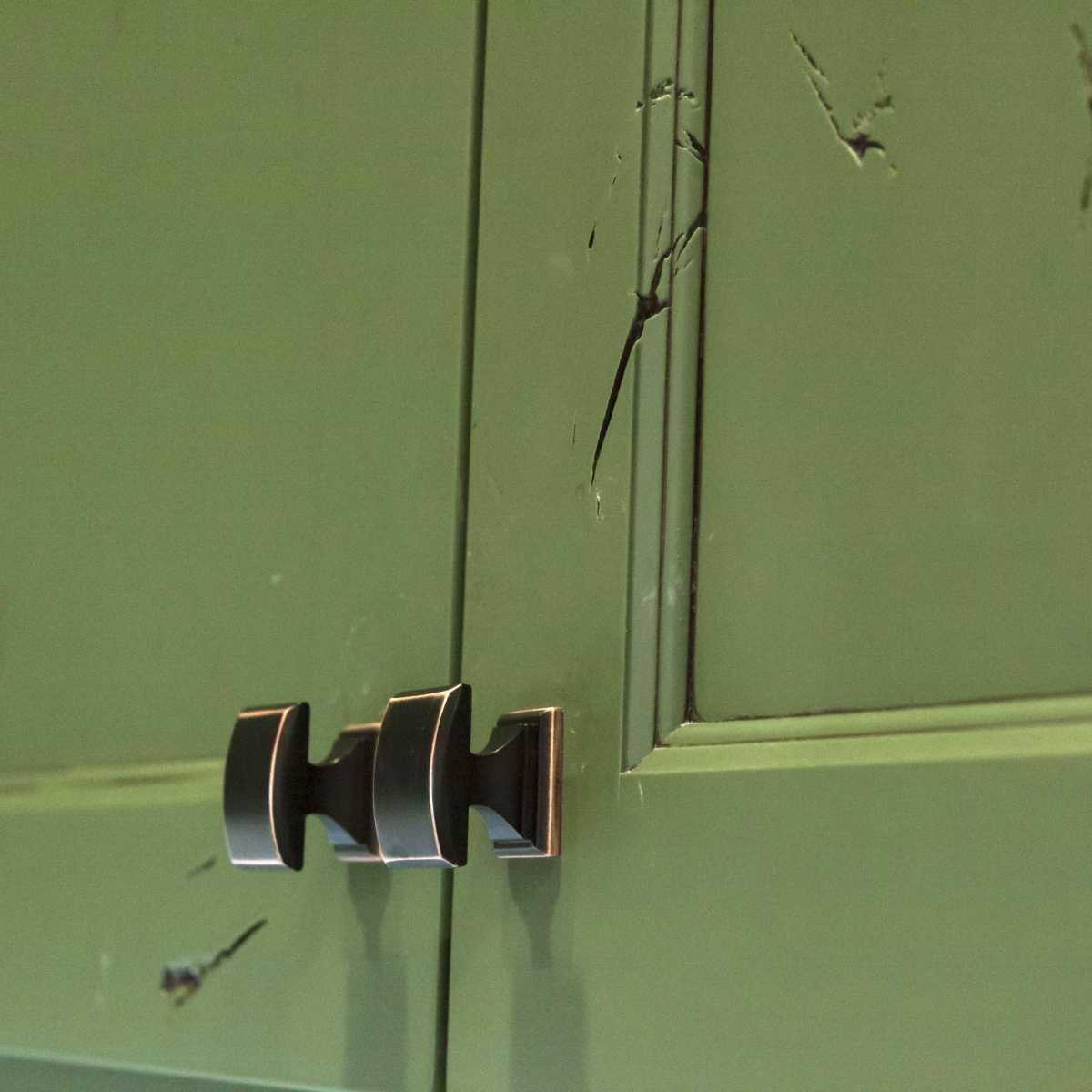 The oil-rubbed bronze cabinet hardware.