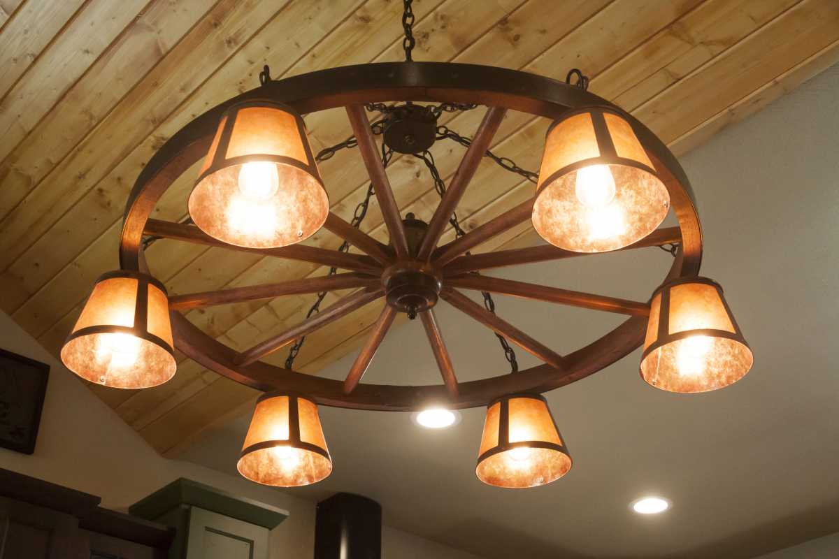 The wheel chandelier that tied everything together in the kitchen!
