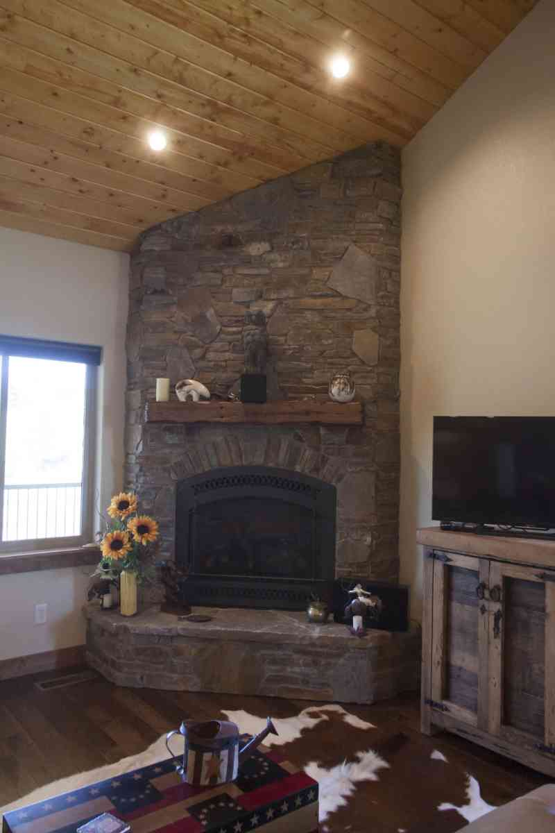 The rustic living room fireplace with a custom-made mantle.