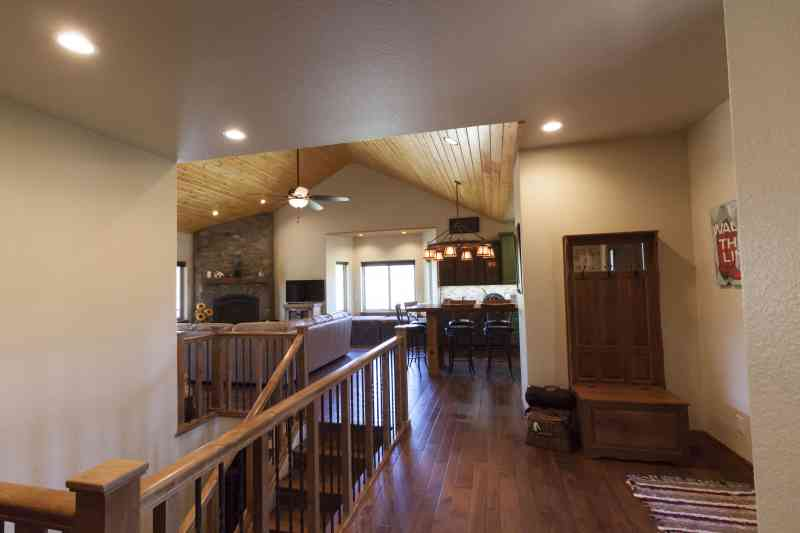 The entryway opens up to the kitchen and living room.
