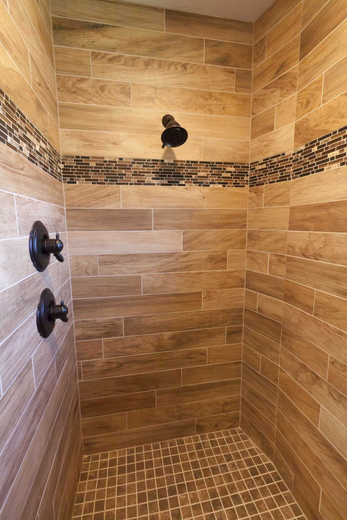 The beautiful wood-like tile in the master walk-in shower.