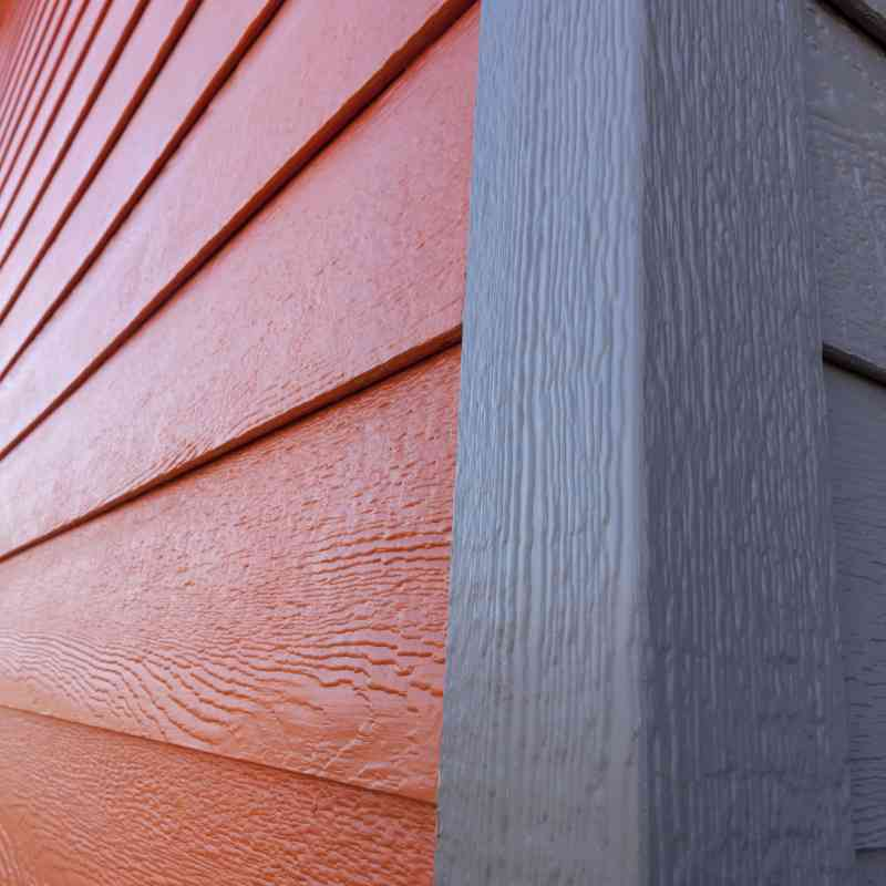 Close-up detail of the siding color contrasts.