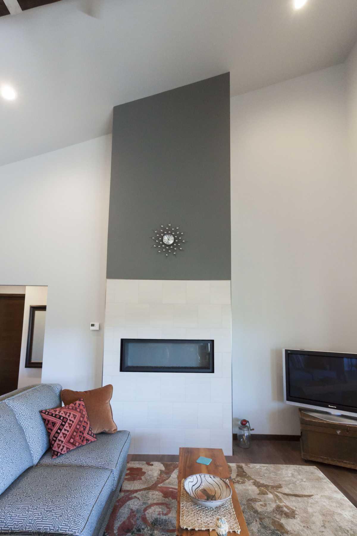 The sleek, tiled living room fireplace.