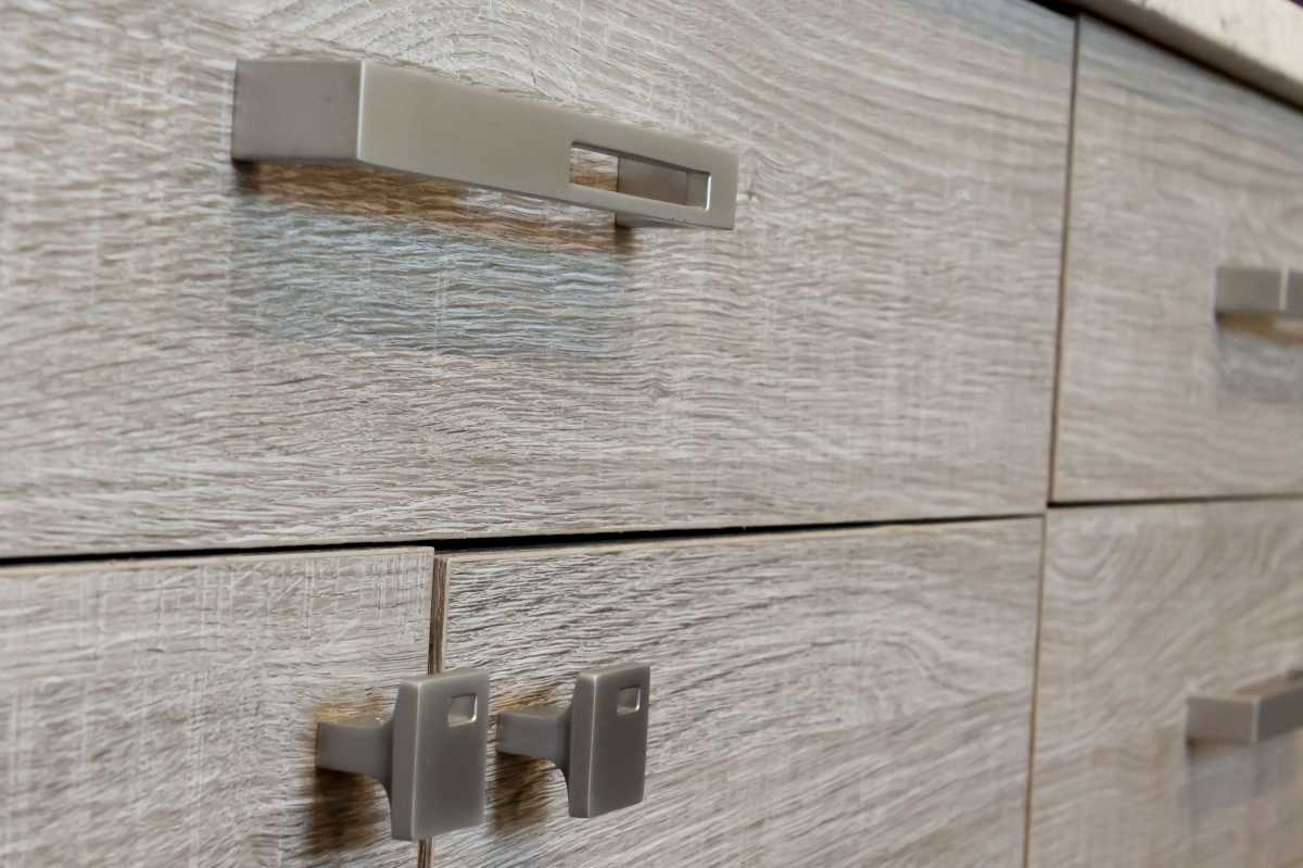The kitchen cabinets are finished off with brushed nickel hardware.