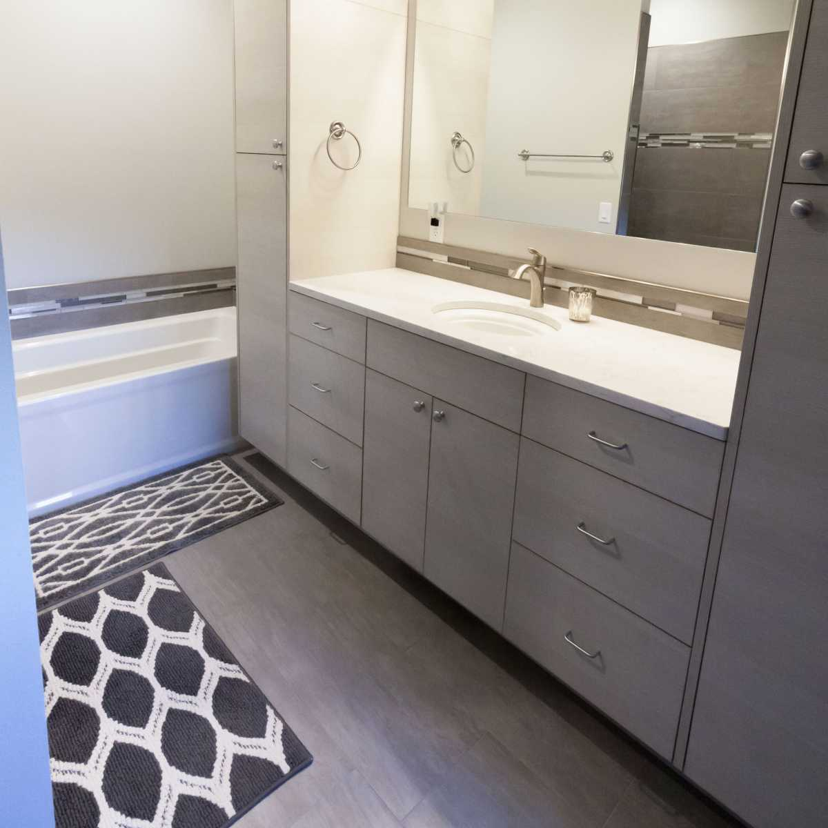 Sleek modern cabinetry for the guest bath.