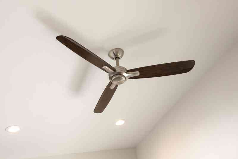 The modern ceiling fan in the breezeway.