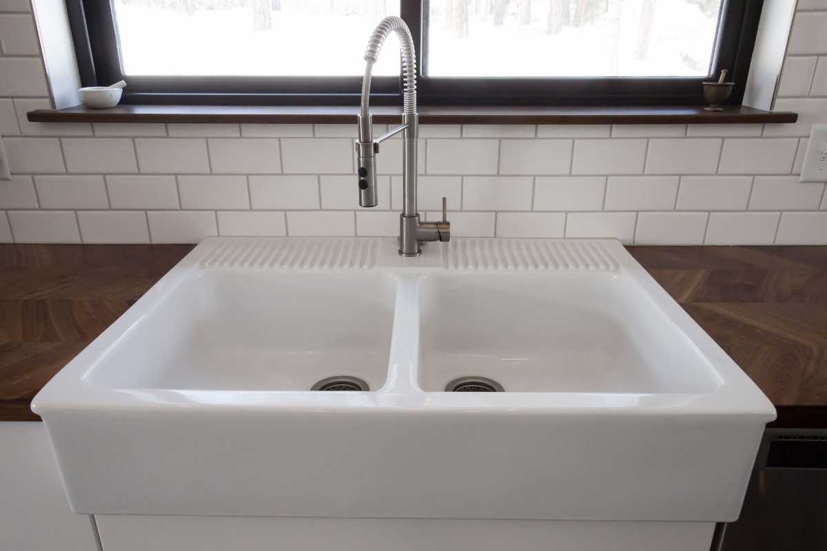 This kitchen is now complete with a large farmhouse sink!