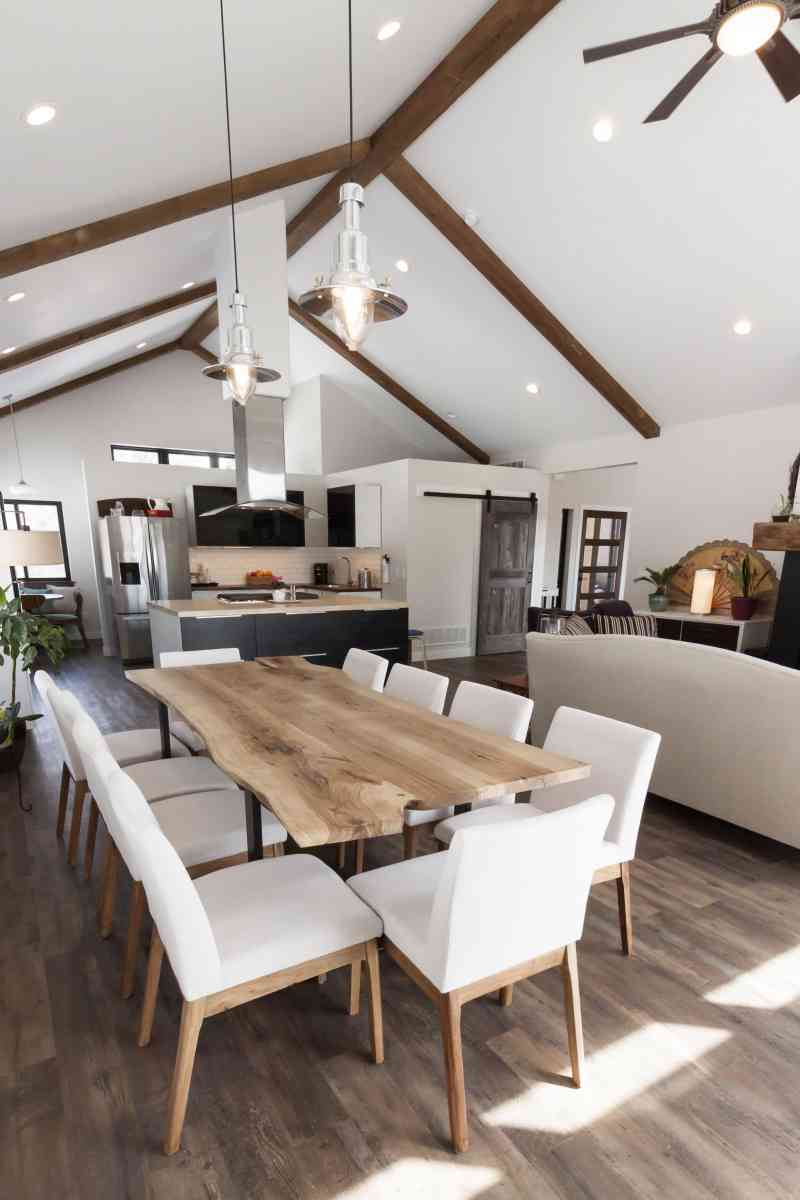 The custom, live-edged dining room table fits in perfectly with this open concept living area!