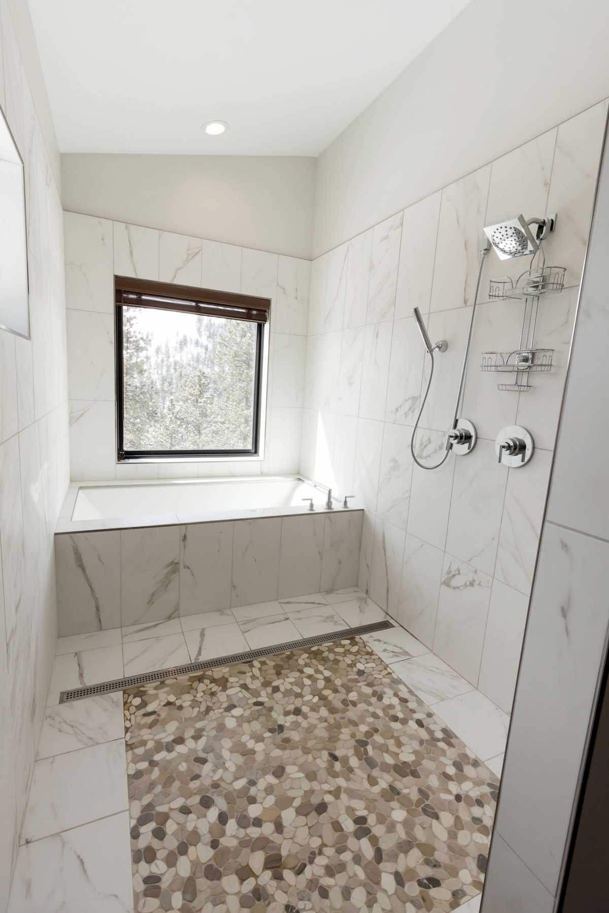 The tub and shower room provide a spa-like experience and overlook the canyon in the backyard!